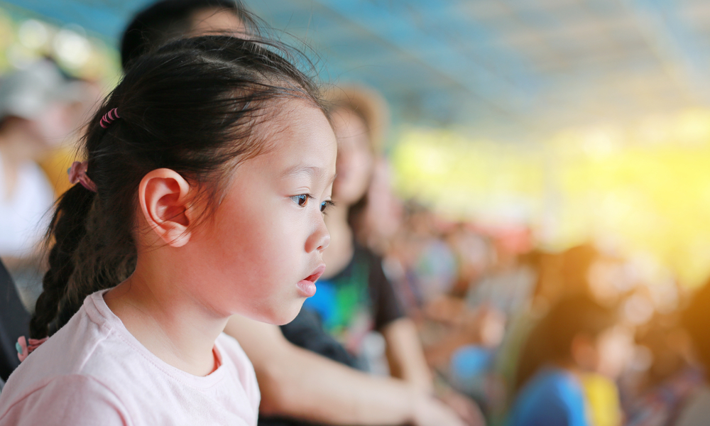 young girl watching live show