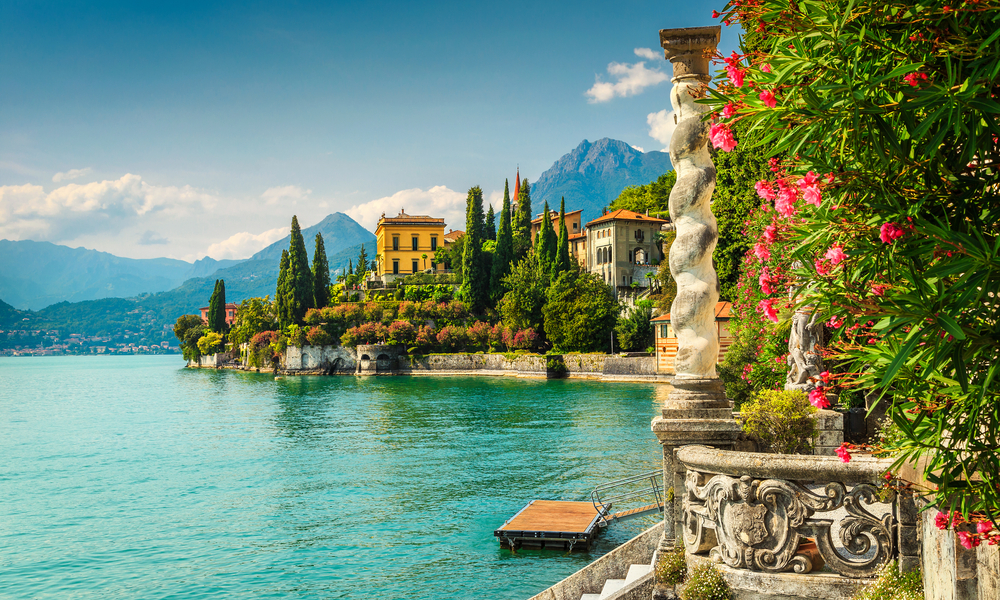 Famous luxury villa Monastero, stunning botanical garden decorated with mediterranean oleander flowers, lake Como, Varenna,