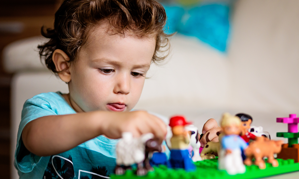 toddler playing with legos