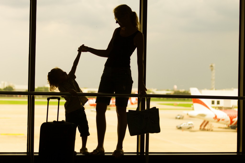 Woman and child silhouette at airport
