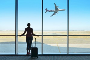 woman watching plane airport