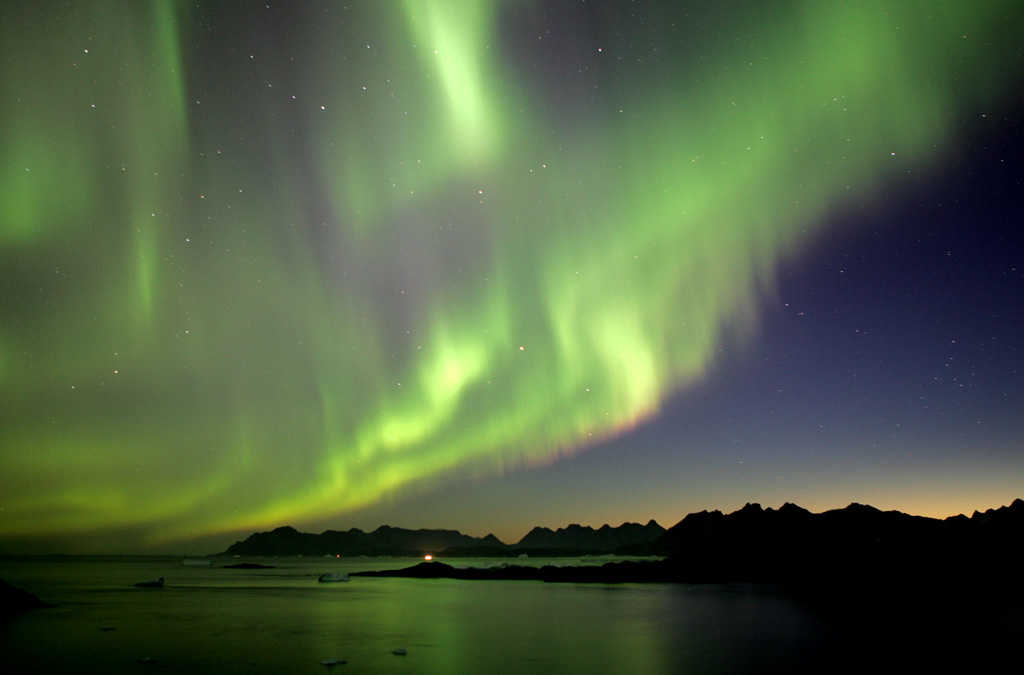 """""""Northern Lights, Greenland"""" by Nick Russill is licensed under CC 2.0."""