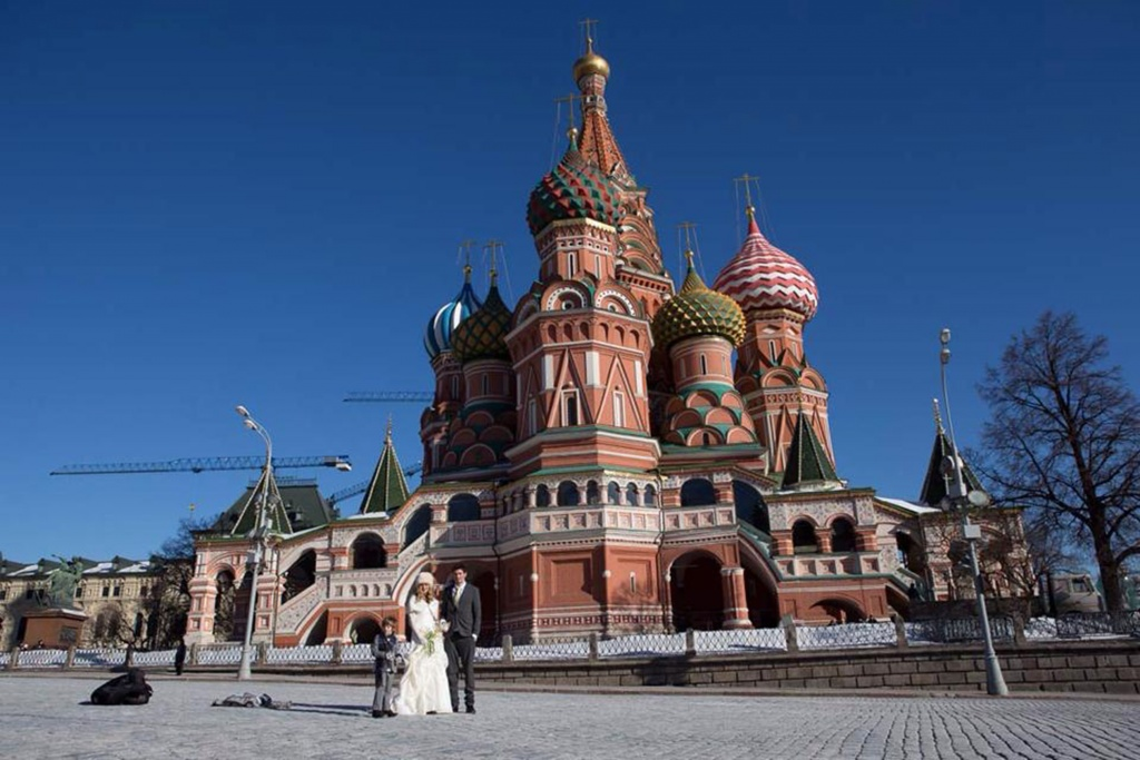 PIC FROM FORTITUDE PRESS (PICTURED - AMELIA AND BRETT GETTING MARRIED IN MOSCOW) A LOVED-UP couple whose wedding plans were dashed after they clashed with a family member's marriage have gone on to tie the knot in EIGHT different countries. Amelia Irwin, 32, was faced with a dilemma after her wedding was planned in the same month as that of a family member of her partner Brett, 33, last year. But the couple, who met nine years ago, decided to tie the knot in a registry office so they could save £10,000 which they went on to use to travel the globe. And since they got married in Trowbridge last year, the couple have been blessed and enjoyed ceremonies at locations across the globe including Paris, Moscow, Beijing and Nepal. SEE FORTITUDE PRESS COPY