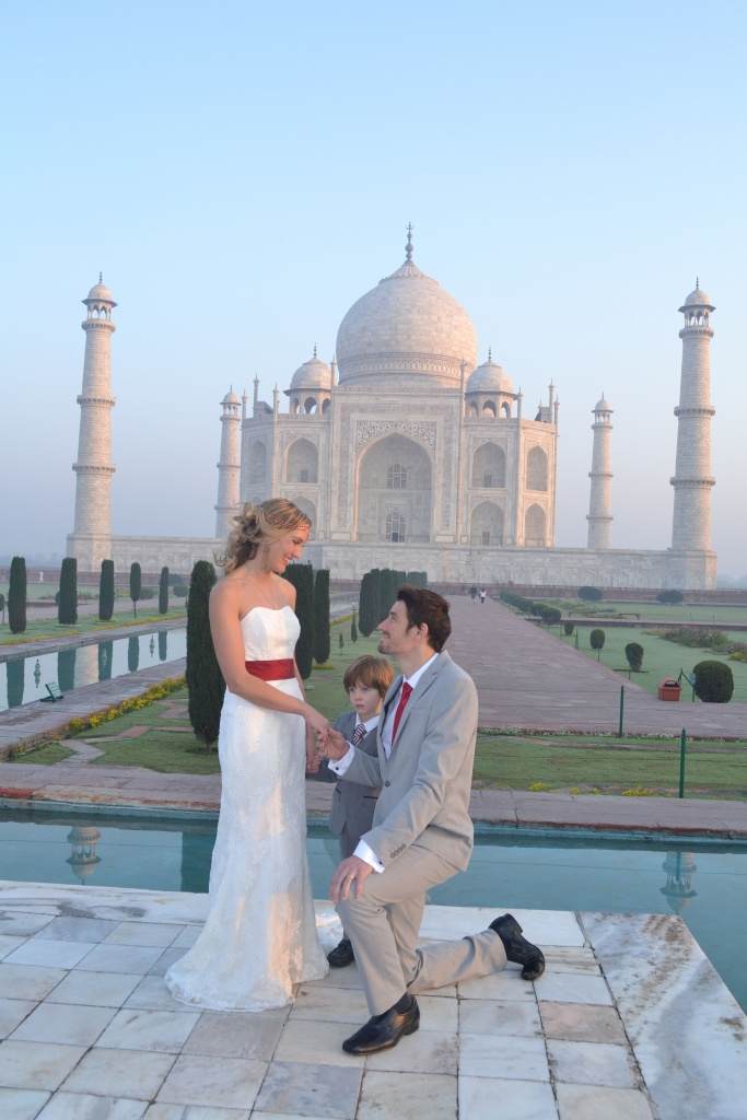 PIC FROM FORTITUDE PRESS (PICTURED - AMELIA AND BRETT GETTING MARRIED IN INDIA AT THE TAJ MAHAL) A LOVED-UP couple whose wedding plans were dashed after they clashed with a family member's marriage have gone on to tie the knot in EIGHT different countries. Amelia Irwin, 32, was faced with a dilemma after her wedding was planned in the same month as that of a family member of her partner Brett, 33, last year. But the couple, who met nine years ago, decided to tie the knot in a registry office so they could save £10,000 which they went on to use to travel the globe. And since they got married in Trowbridge last year, the couple have been blessed and enjoyed ceremonies at locations across the globe including Paris, Moscow, Beijing and Nepal. SEE FORTITUDE PRESS COPY