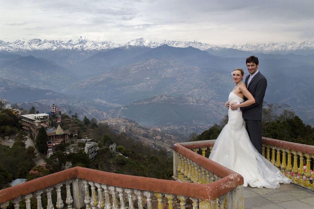 PIC FROM FORTITUDE PRESS (PICTURED - AMELIA AND BRETT GETTING MARRIED IN NEPAL, NEAR MOUNT EVEREST) A LOVED-UP couple whose wedding plans were dashed after they clashed with a family member's marriage have gone on to tie the knot in EIGHT different countries. Amelia Irwin, 32, was faced with a dilemma after her wedding was planned in the same month as that of a family member of her partner Brett, 33, last year. But the couple, who met nine years ago, decided to tie the knot in a registry office so they could save £10,000 which they went on to use to travel the globe. And since they got married in Trowbridge last year, the couple have been blessed and enjoyed ceremonies at locations across the globe including Paris, Moscow, Beijing and Nepal. SEE FORTITUDE PRESS COPY