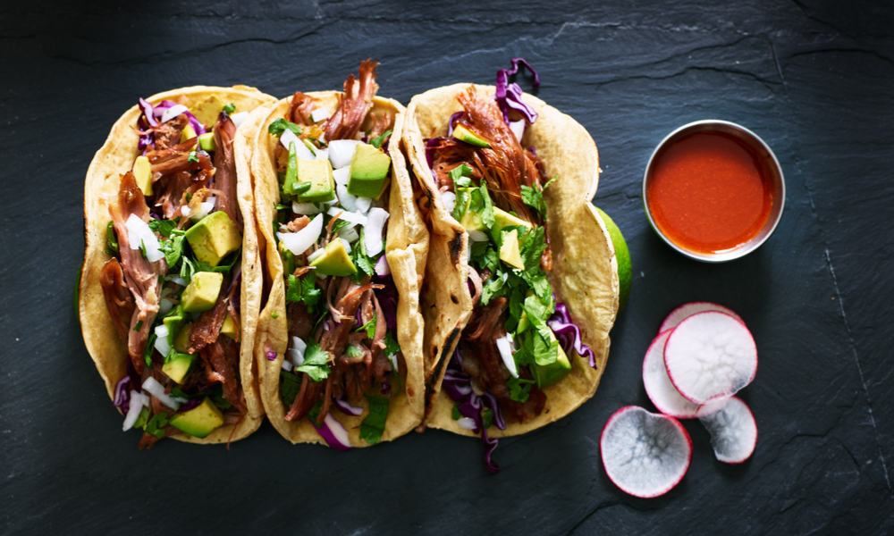 three tacos with salsa