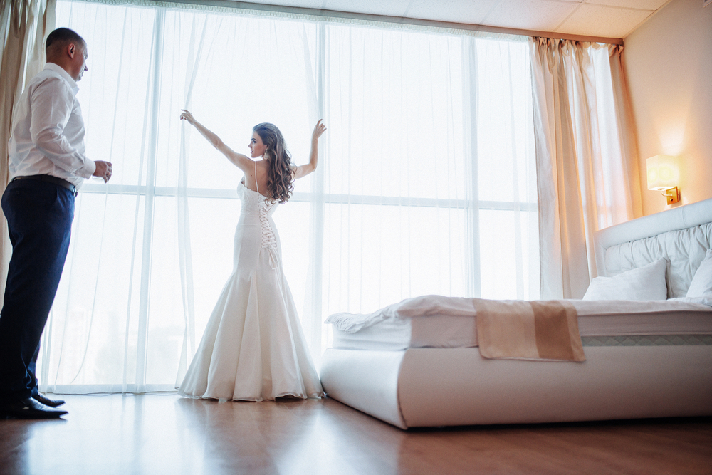 Wedding couple in hotel room