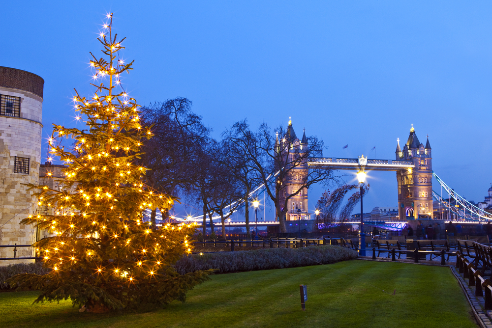A view of Tower Bridge and a Christmas Tree in London.