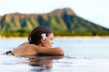 woman overlooking island infinity pool
