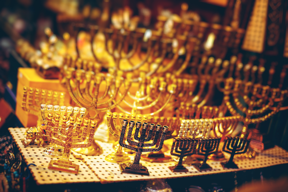 Menorah Show Case at the Jerusalem Old City Bazaar. Abstract Blurred Background. Selective Focus, Shallow DOF.