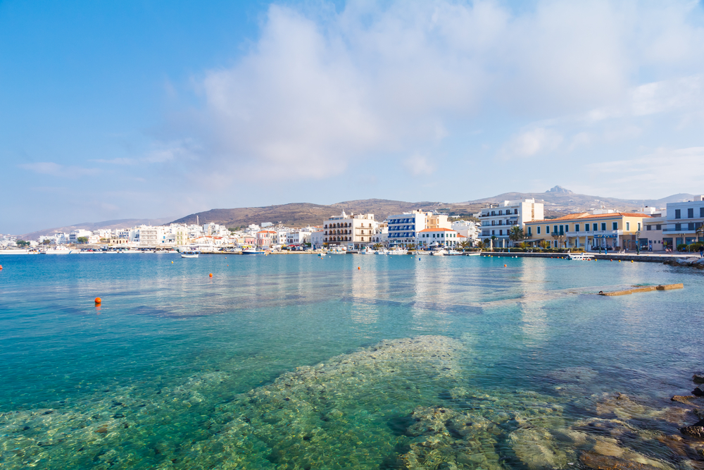 Tinos city and harbor in Cyclades against a blue sky, Greece