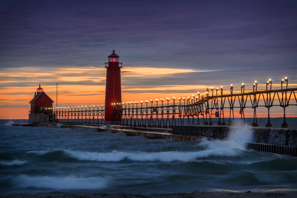 Sunset at the Grand Haven South Pierhead Inner Light with Entrance Light in background in Grand Haven State Park in Grand Haven, Michigan