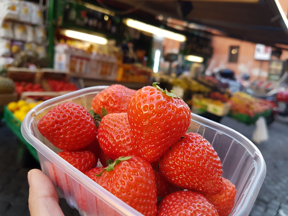 a package of fresh strawberries, Rome, Italy.