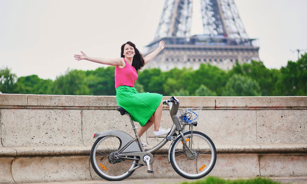 a girl cycling in paris