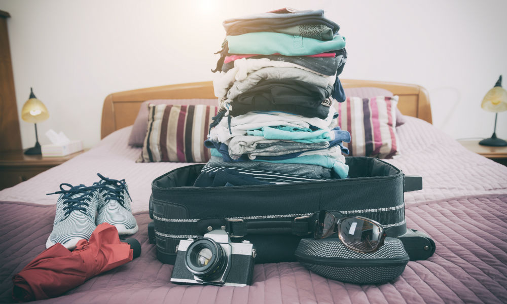clothes and bags on the bed