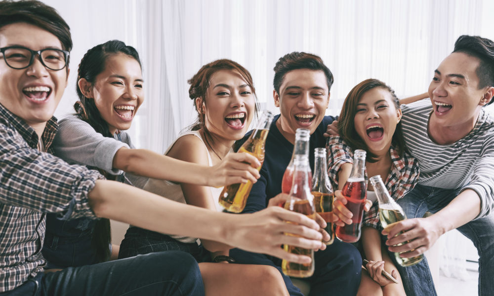 group of young people enjoying drinks