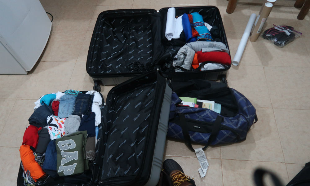 packing our bags - downsized from 7 to 4 bags!