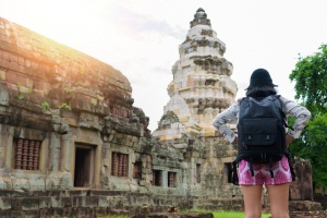 Asian woman backpacker solo travels outdoor lifestyle at ancient in Thailand