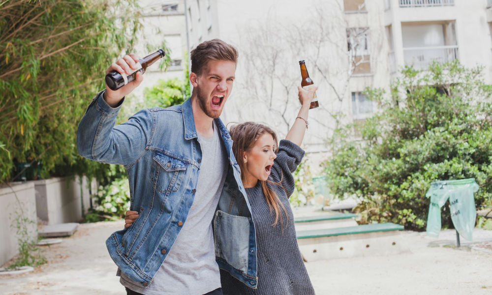 young couple drinking and boisterous in public