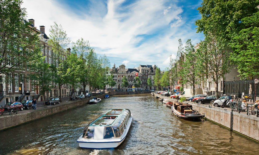 a canal cruise boat in amsterdam