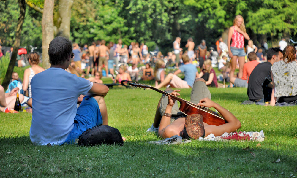 people relaxing in vondelpark