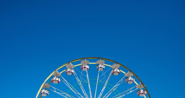 Carnival Ferris Wheel with Clean Skies with Empty Space Close up shot of half of a ferris wheel in Coachella California.