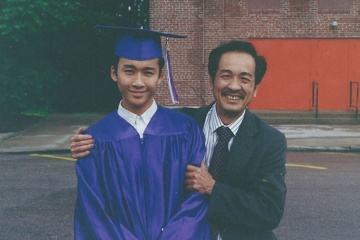 Kenneth and his father on his graduation day