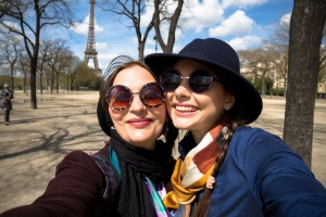 Mother and adult daughter are doing selfie in park in summer going crazy and laughing. Sunset light.Happy and positive emotions.Two friends on vacation.Parents and teenagers.Autumn self-portrait