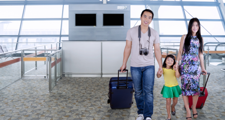 asian american family at airport