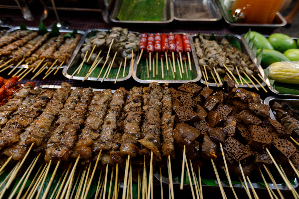 Barbecued pork and chicken at a food stall at Bonifacio night market in Manila, Philippines