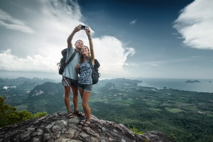 Couple taking seflie on mountain
