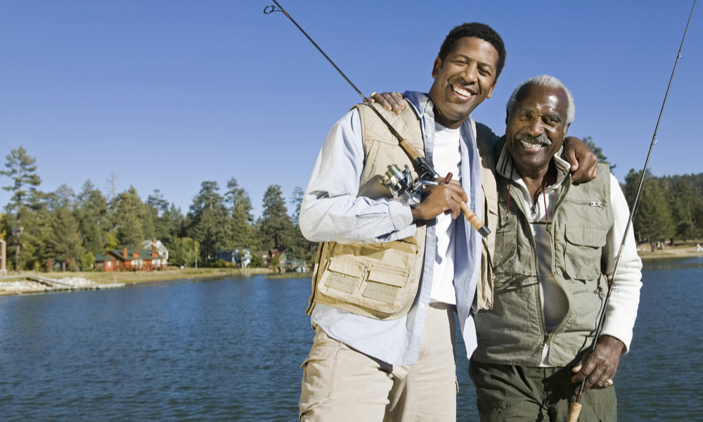 Adult son and senior father fishing trip