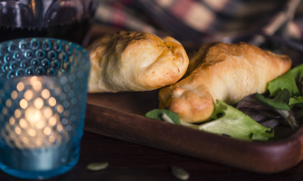 Food from Patagonia: Two lamb stuffed empanadas and a glass of local red wine in a chic retreat in the south of the world.