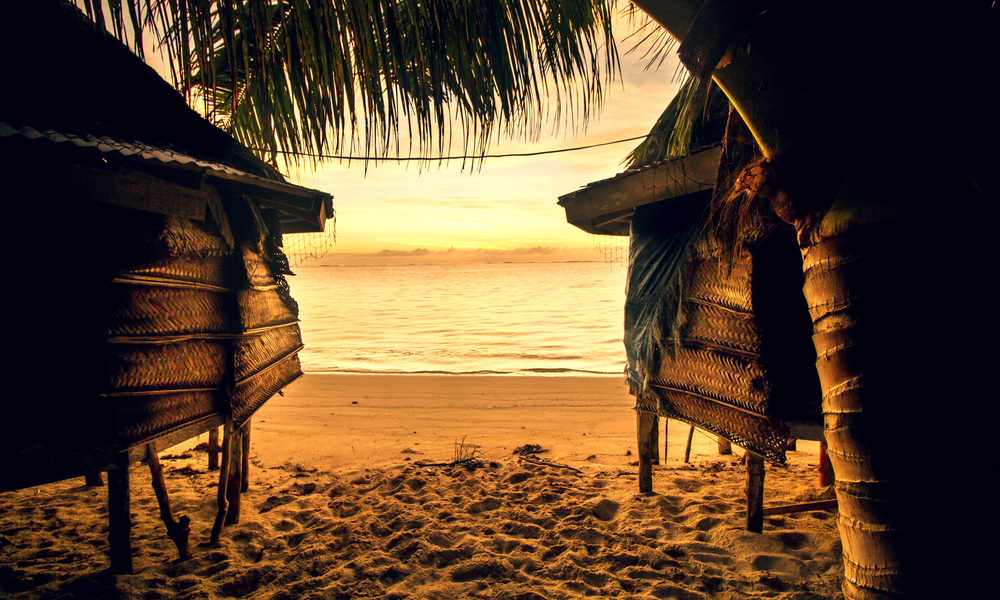 two huts on a beach