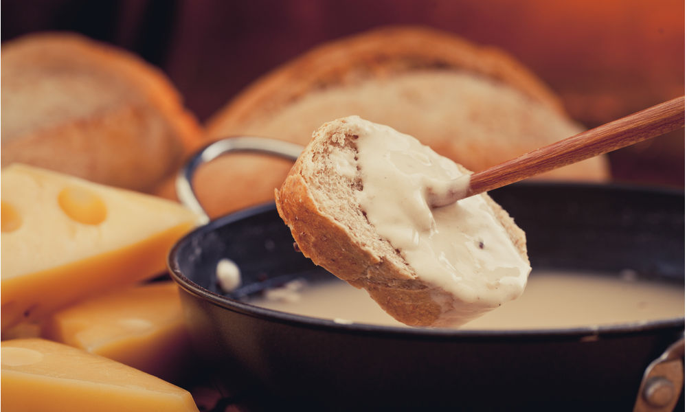 bread dipped on a cream sauce