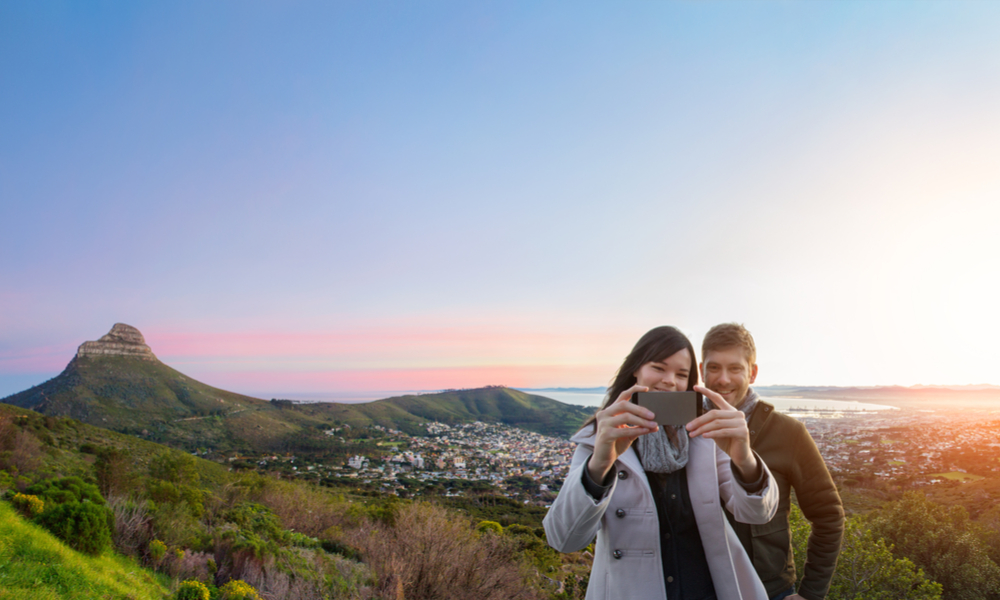 couple taking a selfie with cape town in background