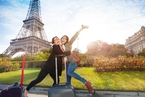 happy tourists in paris