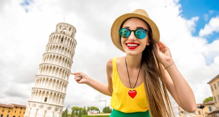 woman in front of tower of pisa, italy