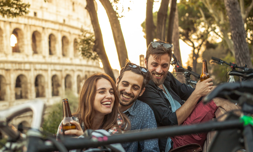 friends in Rome having a beer at sunset
