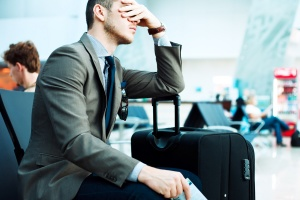 man upset because of delayed flight