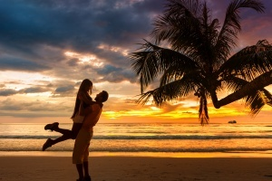 Couple enjoying valentine's Day trip to Fiji on the beach