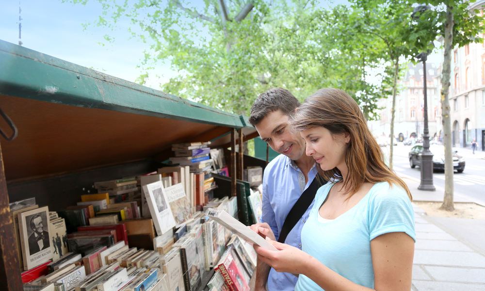 a couple at a book market in Paris