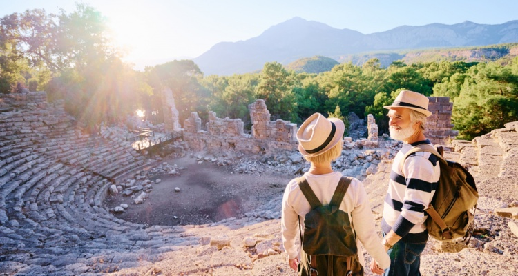 Senior family couple enjoying view together on ancient amphitheatre.
