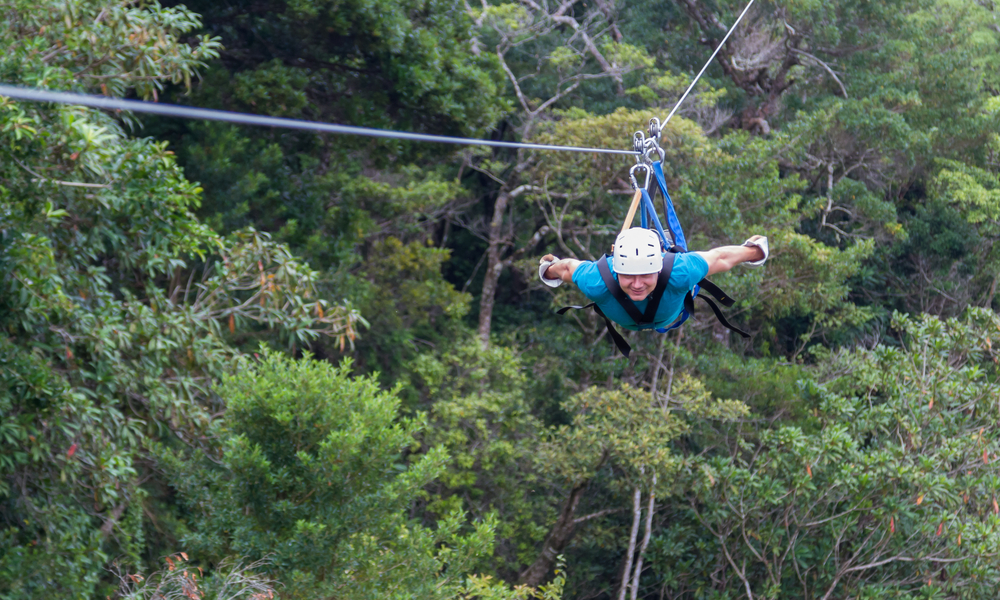 person ziplining in costa rica