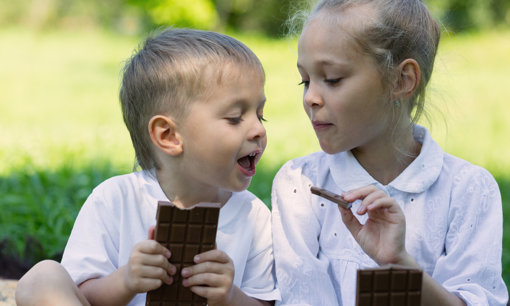 two kids enjoying some Chocolate