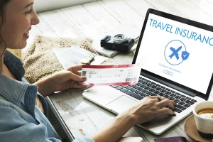 Woman looking at travel insurance online