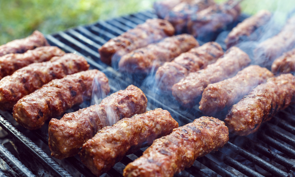 "traditional food Meat Balls ""mici"" on grill"