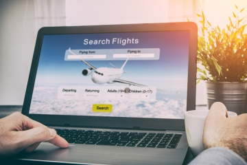 man booking flight online