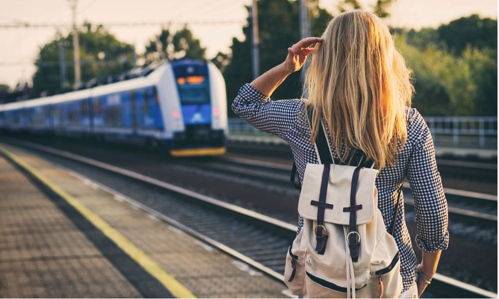 Backpacker travelling through Europe by train.