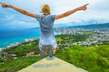 Happy hiker jumping. Hawaiian hiking by popular Diamond Head hike.